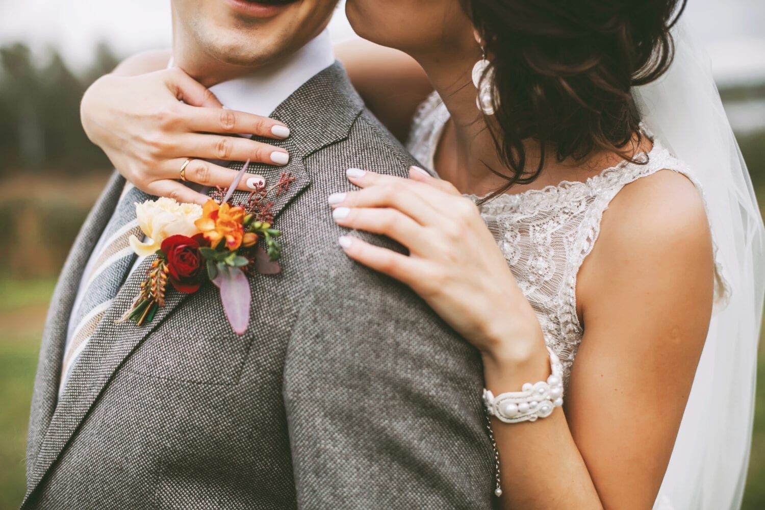Stylish couple on their autumn wedding day and their accessories: boutonniere, bracelet